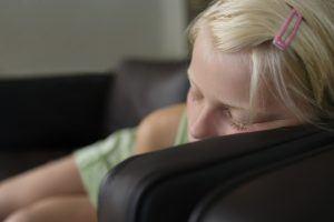 Close-up of girl (7-9) sleeping on sofa